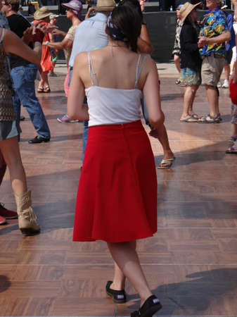 PORTLAND, OREGON - JUN 30, 2017 - Couples dancing to zydeco blues music  at the  4th of July weekend Blues festival in  Portland,  Oregon 新闻类图片