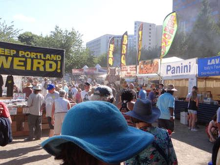 PORTLAND, OREGON - JUL 1, 2017 - People explore the food veendors stalls at the  4th of July weekend Blues festival in  Portland,  Oregon