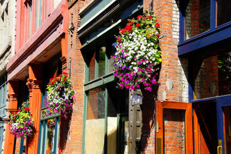 Huge hanging flower baskets decorate  Pioneer Square,  Seattle, Washington