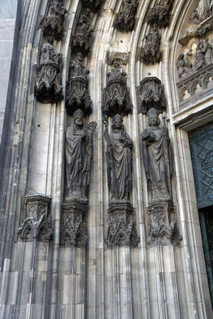 st: COLOGNE, GERMANY - SEP 15, 2016 - Statues in St Peters Cathedral,  Cologne, Germany Editorial