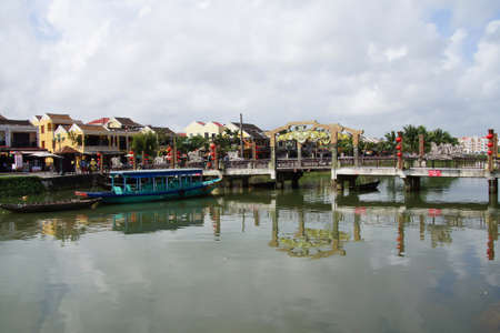 Wooden boats in the canal of  Hoi An, Vietnam