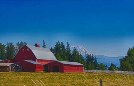 Red barn with Mount Rainier in the background, near Enumclaw, Washington Editorial