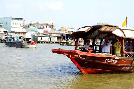 CAI RANG, VIETNAM - FEB 7, 2015 - Tourist tender boat visits the floating market on the Mekong River,  Vietnam Editorial