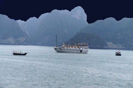 ship anchor: Cruise ships anchor at twilight with karst islands in background  in Halong Bay, Gulf of Tonkin,  Vietnam Stock Photo