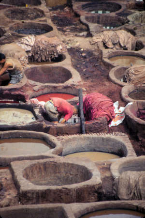 FEZ, MOROCCO - OCT 17, 2000 - Leather tanning and dying pits in the old city of  Fez, Morocco Banco de Imagens