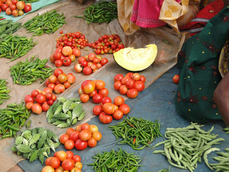 Piles of tomatoes, hot peppers and other vegetables  at the weekly market in Ankadeli, Orissa in India Stock Photo