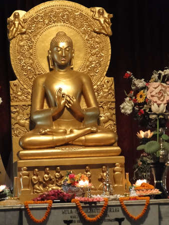 Statue of buddha teaching after enlightenment under the bodhi tree in on Nov 7, 2009, in Varanasi, India.