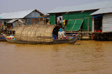 Stilt houses and boats during dry season at the Kompong Kleang floating fishing village,  Cambodia Stock Photo