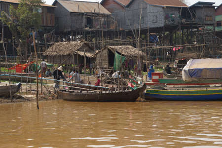 KOMPONG KLEANG, CAMBODIA - FEB 12, 2015 -  Stilt houses and boats during dry season at the Kompong Kleang floating fishing village,  Cambodia