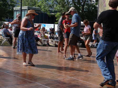 PORTLAND, OREGON - JUL 1, 2017 - Dancers sway to the music at the  4th of July weekend Blues festival in  Portland,  Oregon