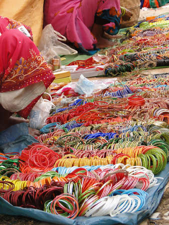 Selling bangles and other jewelry at the weekly market in Kunduli, Orissa in India Stock Photo