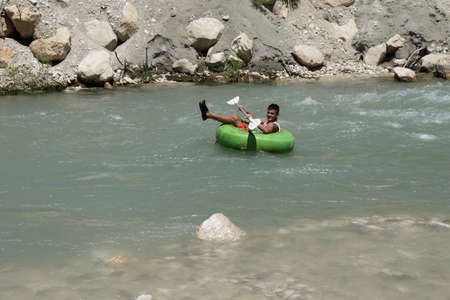 Tourist surfs the whitewater  emerging from Saklikent gorge in  Turkey