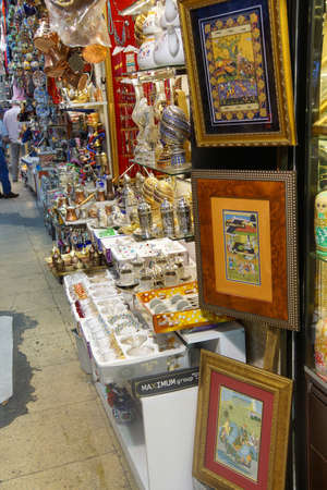 ISTANBUL - May 14, 2014 - Miniature paintings and Brass tea sets and serving platters in the Grand Bazaar (Kapali carsi ) in Istanbul, Turkey
