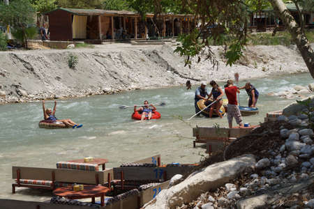 SAKLIKENT, TURKEY - MAY 31, 2014 - Tourist surfs the whitewater  emerging from Saklikent gorge in  Turkey