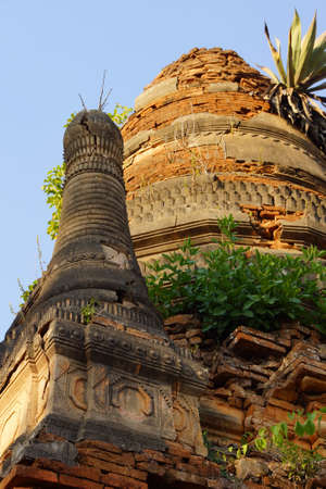 Vegetation reclaims ancient  Buddhist stupas at In Dein on  Inle Lake,  Myanmar (Burma)