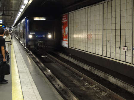 arrives: PARIS - SEP 14, 2011 - A Paris Metro train arrives in an underground station  on Sep 14, 2011, in Paris, France