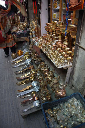 Brass lamps and other household items in the market, Leh, Ladakh, India