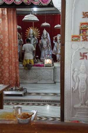 JAIPUR, INDIA - OCT 9, 2017 - Dressing the god in the morning, Khole Ke Hanuman Ji Temple, Jaipur, Rajasthan, India