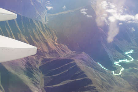 Aerial view of Indus River winding thru lower Himalayan foothills, India Stock Photo