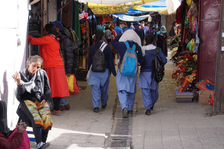 LEH, INDIA - SEP 11, 2017 - Young girls in the market after school, Leh, Ladakh, India