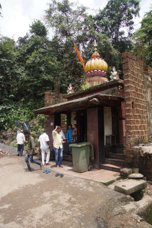 WESTERN GHATS, INDIA - SEP 22, 2017 -Perfroming puja at a small shrine in Karnataka, India