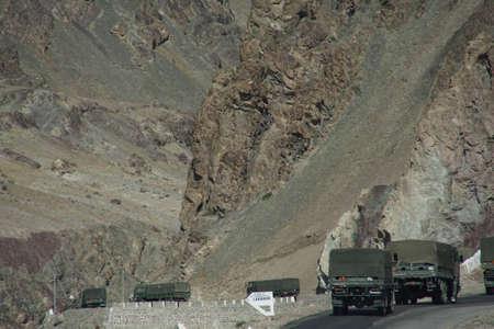 LADAKH, INDIA - SEP 12, 2017 - Indian army truck convoy on narrow road along Indus River,Ladakh, India
