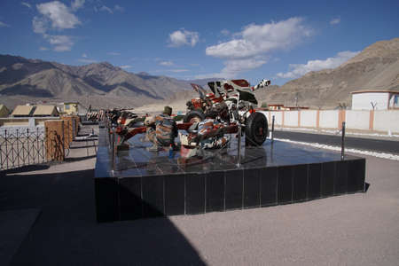 LADAKH, INDIA - SEP 12, 2017 - Soldiers camouflage painting a howitzer cannon, Ladakh, India Editorial