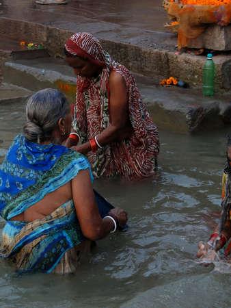 VARANASI, INDIA - NOV 6 - Hindus perform ritual puja at dawn in the Ganges River Varanasi, India