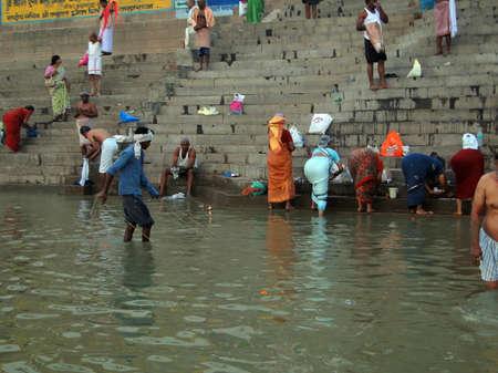VARANASI, INDIA - NOV 6 - Dhobiwallahs wash clothes in the Ganges River on Nov 6, 2009, in Varanasi, India.