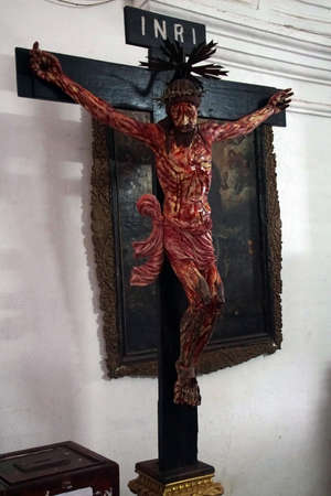 OLD GOA, INDIA - SEP 20, 2017 - Life sized crucifixion statue, Basilica Bom Jesus, Calangute, Goa, India