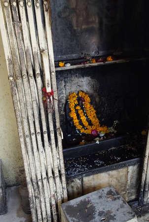 JAIPUR, INDIA - OCT 8, 2017 - Shiva altar with marigolds  outside Govind Devji Temple,  Jaipur, Rajasthan, India