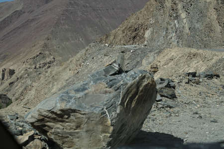 Steep, narrow mountain road with dangerous dropoff on descent from Rizong gompa MonasteryLadakh, India Stock Photo