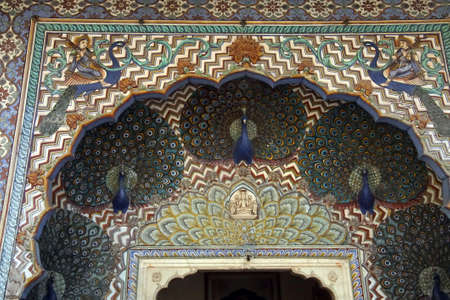 JAIPUR, INDIA - OCT 12, 2017 - Peacock mosaic over the door of City Palace of  Jaipur, Rajasthan, India