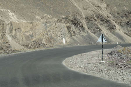 Steep, narrow mountain road with dangerous dropoff on descent from Lamayuru gompa monastery, Ladakh, India