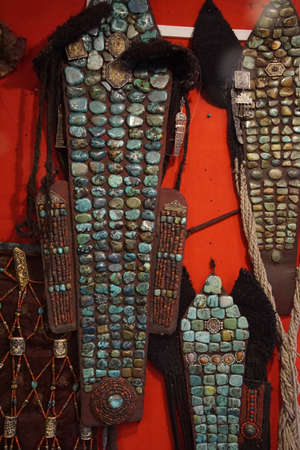 headress: LEH, INDIA - SEP 11, 2017 - Perak traditional womans headress of turquoise  and coral, , India