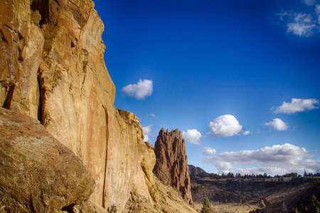Steep walls and jagged peaks along the Crooked River at Smith Rock State Park, Oregon