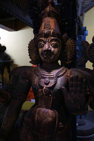 PUNE, INDIA - OCT 2, 2017 - Wooden warrior spirit guarding doorway, Raja Dinkar Kelkar Museum, Pune, India
