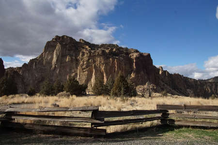 Split rail fence and jagged peaks of Smith Rock State Park, Oregon Stock Photo