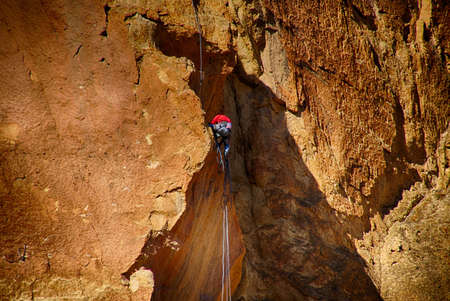Rock climber on steep face at Smith Rock State Park, Oregon Stock Photo