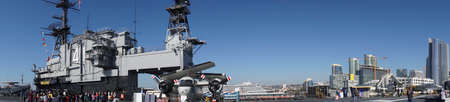 SAN DIEGO, CALIFORNIA - DEC 1, 2017 - Downtown skyscrapers and airplanes on flight deck of USS Midway CV-41 Aircraft Carrier, San Diego, California