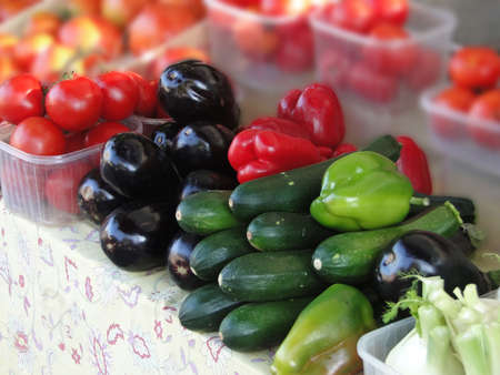 Eggplant and tomatoes for  sale at weekly market in Malaucene, France   Stock Photo