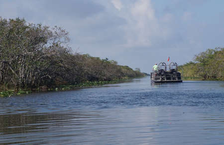 Airboat takes tourists into an everglades canal, Fort Lauderdale, Florida Stock Photo