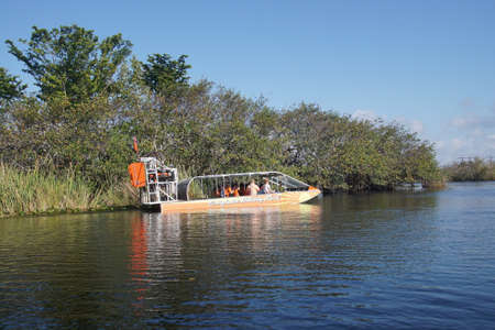 FORT LAUDERDALE, FLORIDA - DEC 21, 2017 - Airboat takes tourists into an everglades canal, Fort Lauderdale, Florida