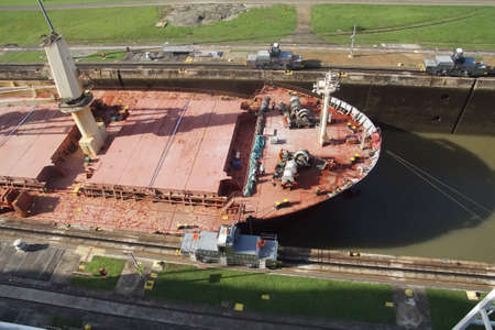 PANAMA CANAL - DEC 16, 2017 - Hawser cables secure freighter through the Panama Canal