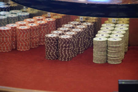 CARIBBEAN SEA - DEC 20, 2017 - Colorful chips of the roulette table of the casino aboard a cruise ship in the Caribbean Sea Redakční