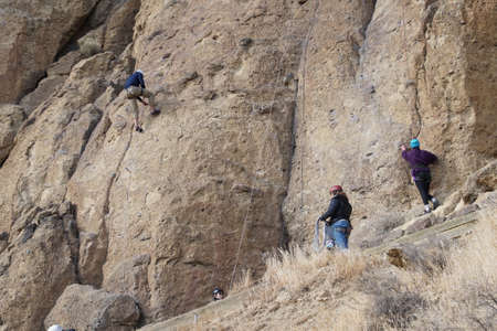 TERREBONNE, OREGON - NOV 6, 2017 - Rock climbers and belayers at Smith Rock State Park, Oregon Stock Photo