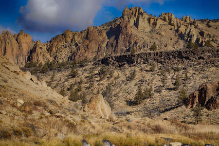 Monument and other jagged peaks  along the Crooked River at Smith Rock State Park, Oregon