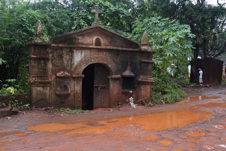 Sunken  building on monsoon soaked street, Calangute, Goa, India Stock fotó