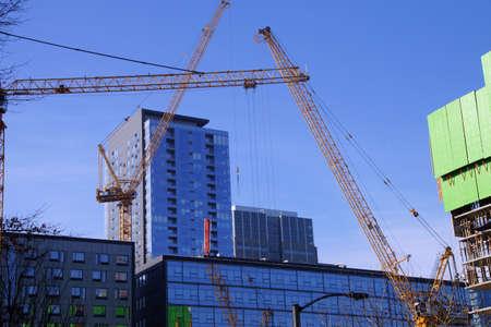 High rise construction cranes  in downtown  Seattle, Washington Standard-Bild - 95926864