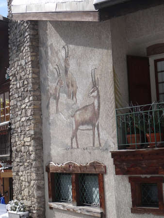 CHATEL, FRANCE - FEB 12, 2018 - Chamois painting on side of building in alpine village of Chatel, France 報道画像
